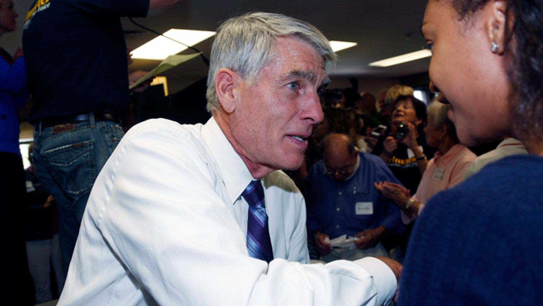 In this Friday, Sept. 5, 2014 photo, U.S. Sen. Mark Udall, D-Colo., is at a campaign headquarters in the northwest Denver suburb of Wheat Ridge.