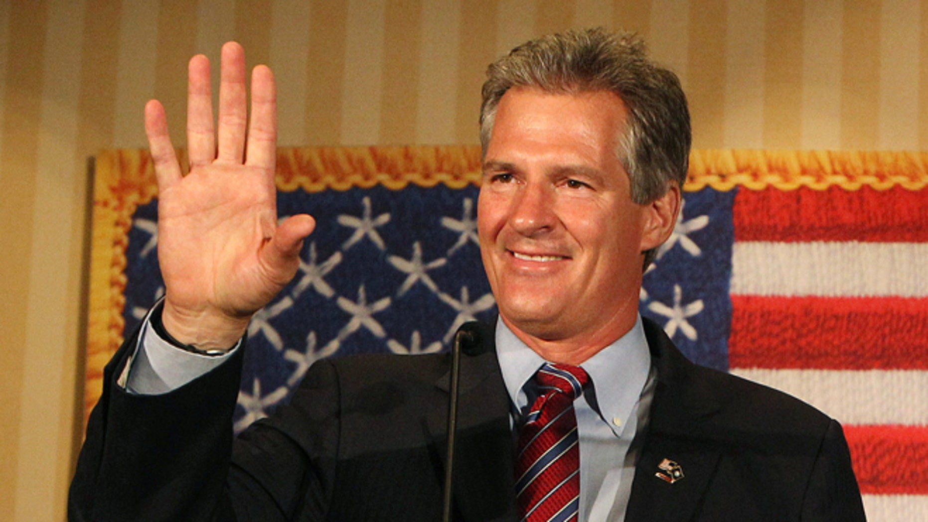 In this Tuesday, Sept. 9, 2014 photo, Scott Brown waves to supporters in Concord, N.H. after winning New Hampshire's Republican U.S. Senate primary.
