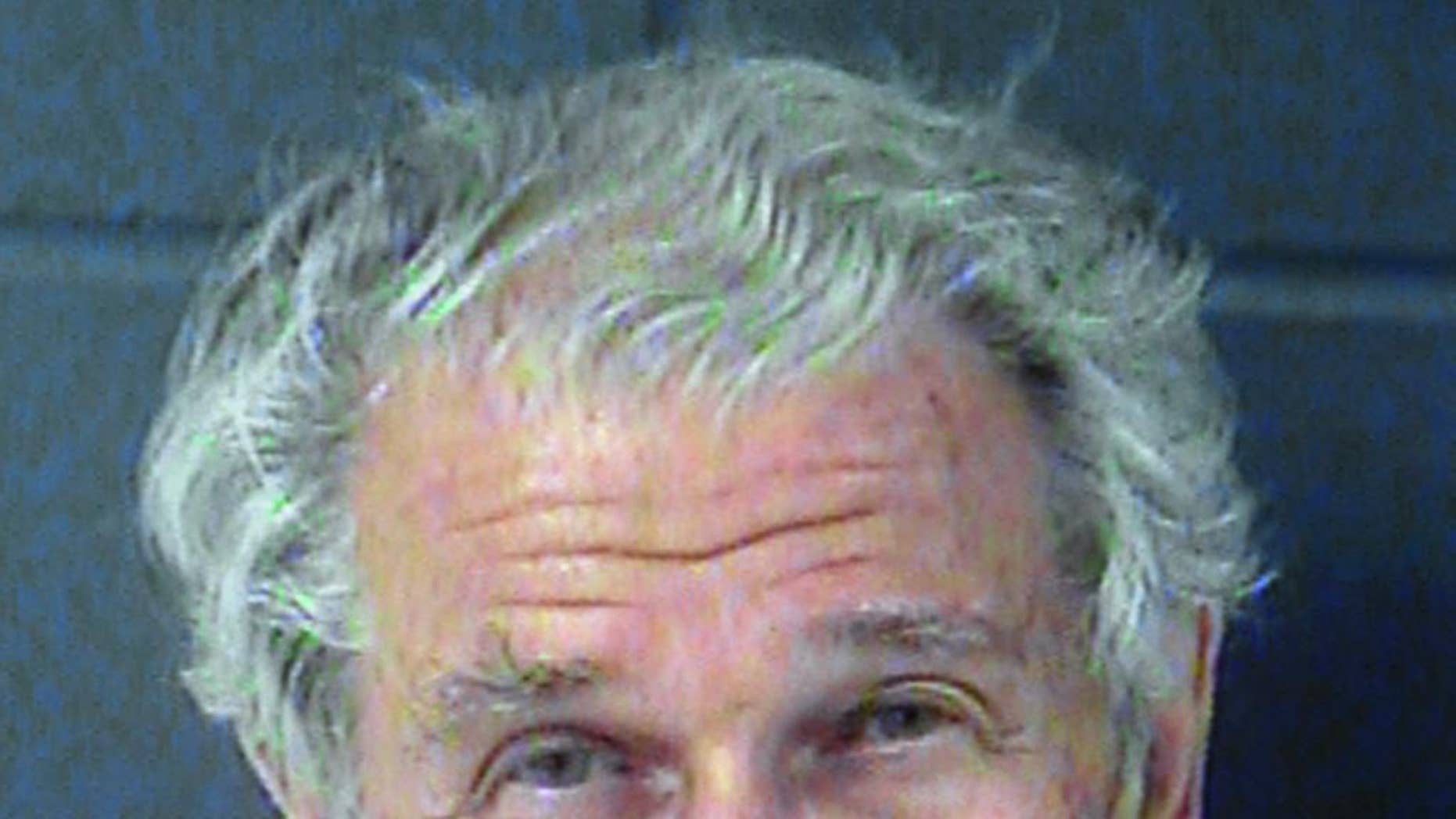 This June 2013 booking photo provided by the Junction City, Kan., Police Department shows Marshall Dion of Tucson, Ariz. (AP Photo/Junction City Police Department)