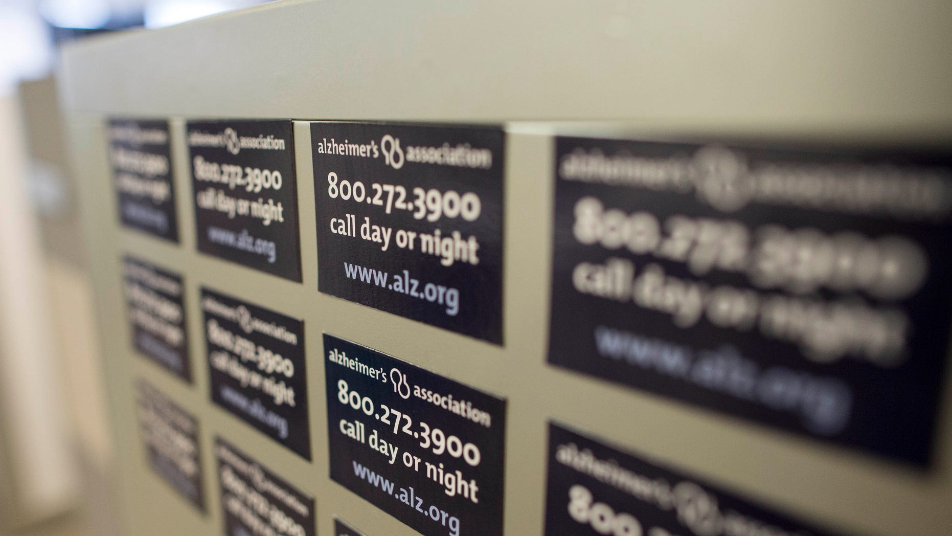 Magnets on a cabinet at the Alzheimer's Association Headquarters in Chicago advertising their help line.