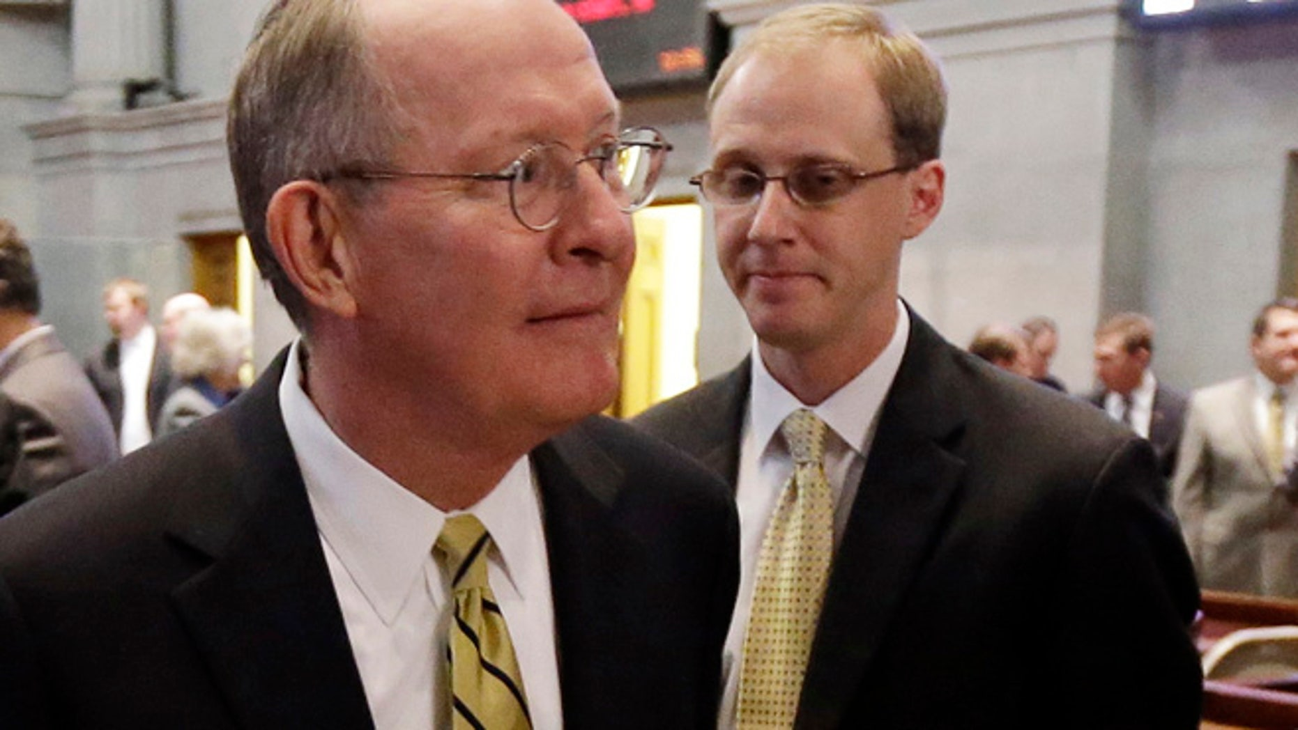 FILE 2013: Sen. Lamar Alexander, R-Tenn., left, leaving the Tennessee House of Representatives chamber with his then-chief of staff, Ryan Loskarn.