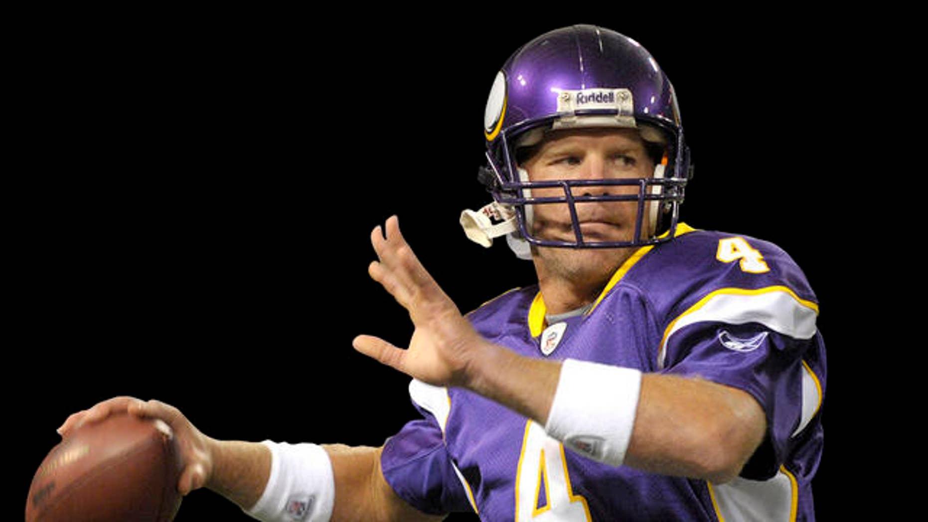 Minnesota Vikings' quarterback Brett Favre harms-up prior to the Vikings NFL pre-season football game against the Kansas City Chiefs  Friday, Aug. 21, 2009 in Minneapolis.(AP Photo/Tom Olmscheid)