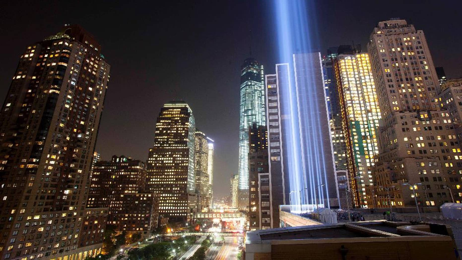 FILE- In this Sept. 10, 2013 file photo, the Tribute in Light rises into the night sky during a test in New York. The National September 11 Memorial and Museum will be closed to the public during the September 11 commemoration ceremony and much of the rest of the day, but it will be open from 6 p.m. to midnight for anyone who wants a close up view of the Tribute in Light. (AP Photo/Mark Lennihan, File)