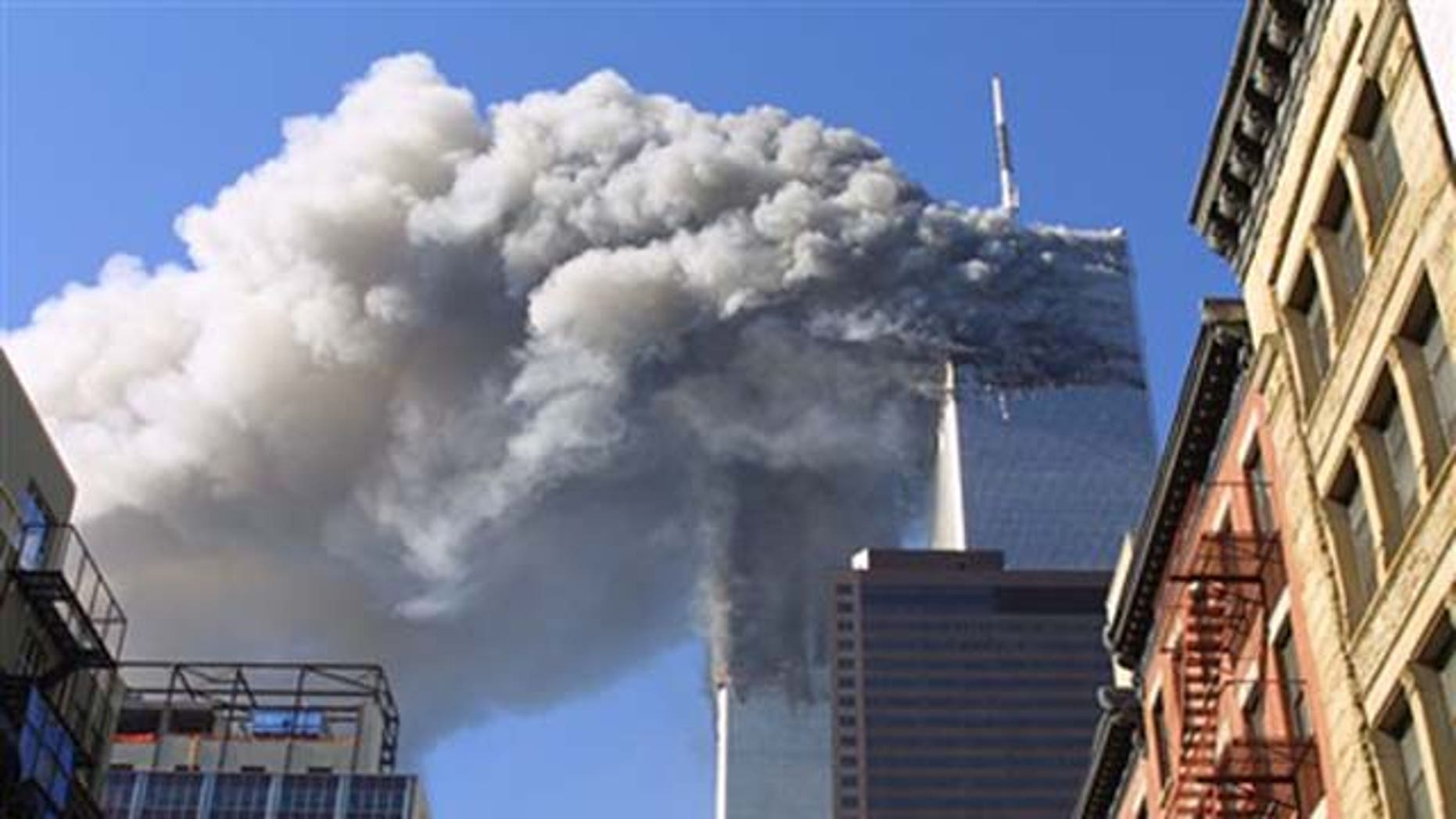 FILE - In this Sept. 11, 2001 file photo, the twin towers of the World Trade Center burn after hijacked planes crashed into them in New York. As the post-Sept. 11 decade ends, some foreign families of the victims are eager to move past the tragedy. But though the pain transcended borders, foreign families have battled to cope with their loss from afar.