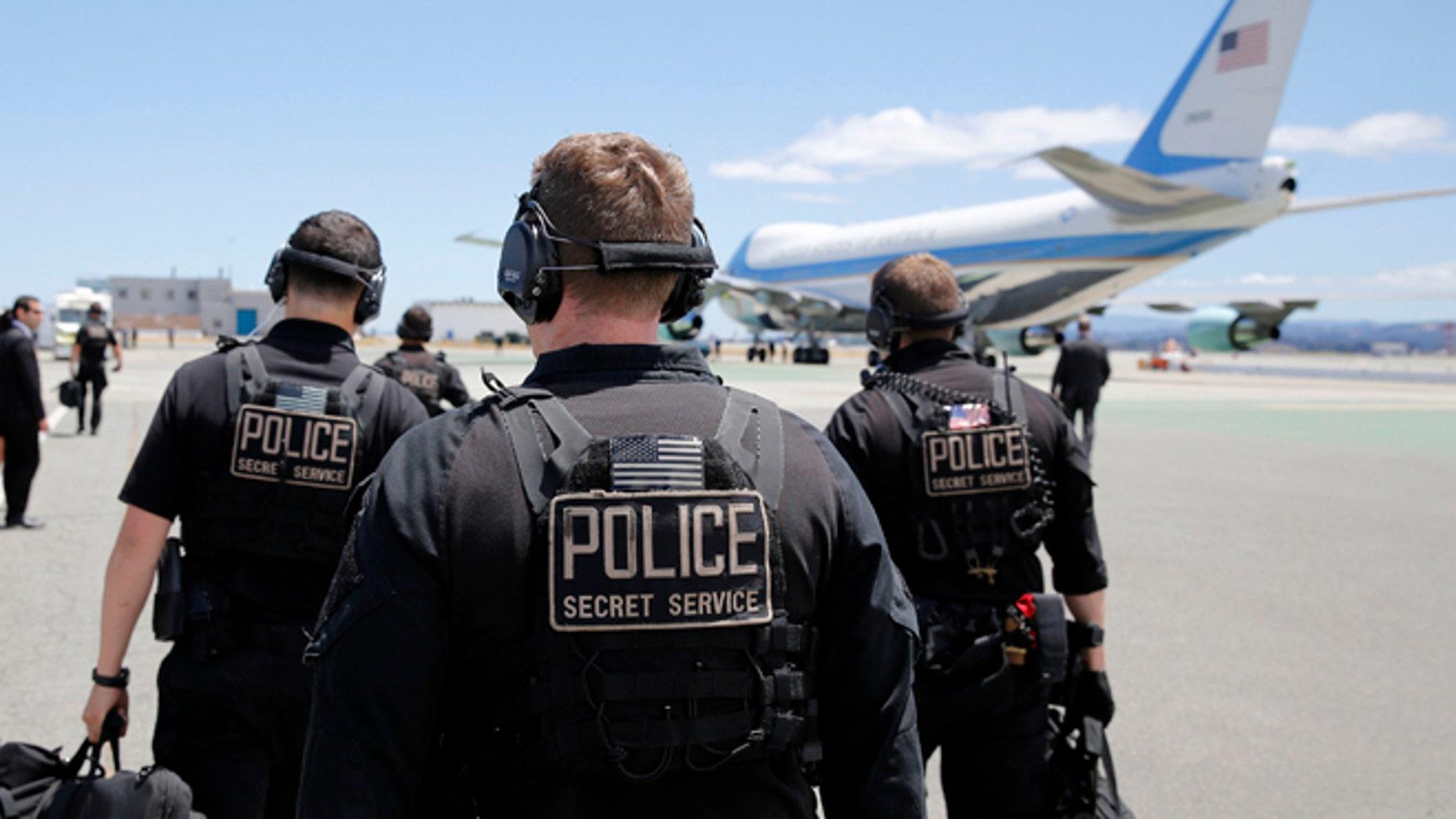 FILE: July 23, 2014: U.S. Secret Service employees walk toward Air Force One at San Francisco International Airport, San Francisco, Calif.