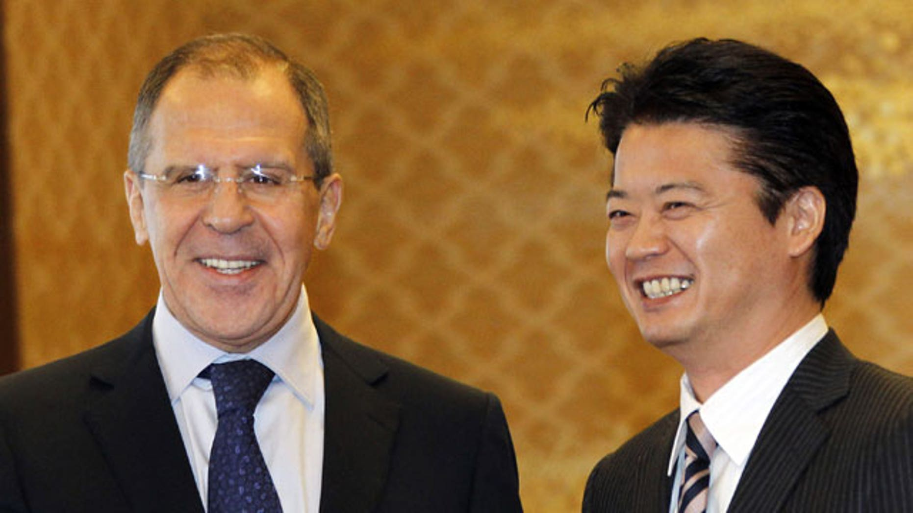 January 28, 2012: Russian Foreign Minister Sergey Lavrov, left, shakes hands with his counterpart Koichiro Gemba prior to their meeting in Tokyo.