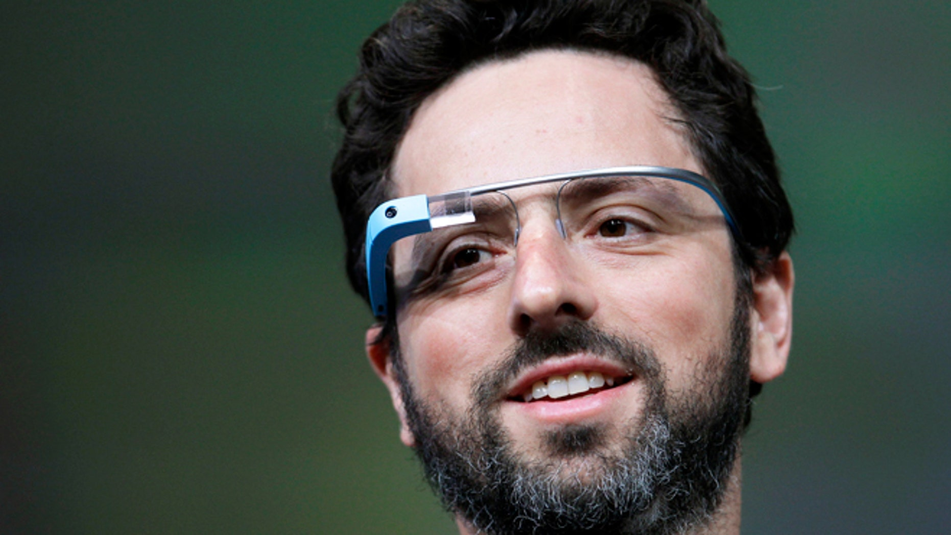 Google co-founder Sergey Brin demonstrating Google's new Glass -- wearable internet glasses -- at the Google I/O conference in San Francisco in 2012.