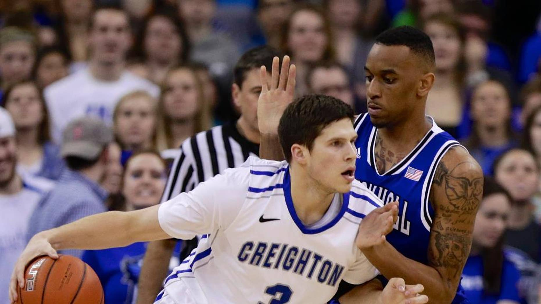 Creighton's Doug McDermott (3) drives around Seton Hall's Brandon Mobley (2) in the first half of an NCAA college basketball game in Omaha, Neb., Sunday, Feb. 23, 2014. (AP Photo/Nati Harnik)