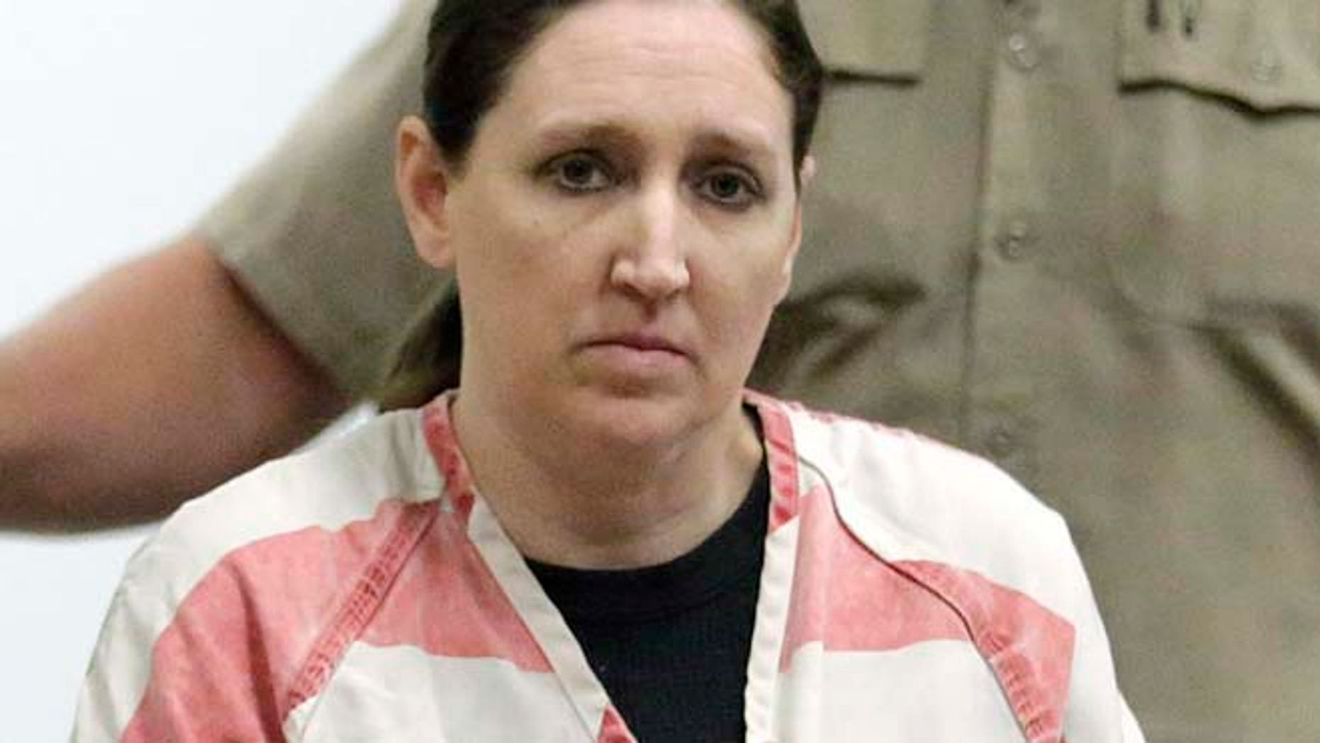 Dec. 8, 2014: Megan Huntsman, who is accused of killing six of her seven newborns and storing all of their bodies in her garage, appears in court in Provo, Utah. (AP)