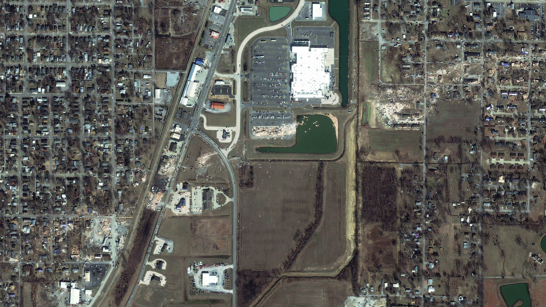 March 1: This satellite image provided by GeoEye shows the path of a tornado, diagonal from bottom left to upper right, which struck Harrisburg, Ill.