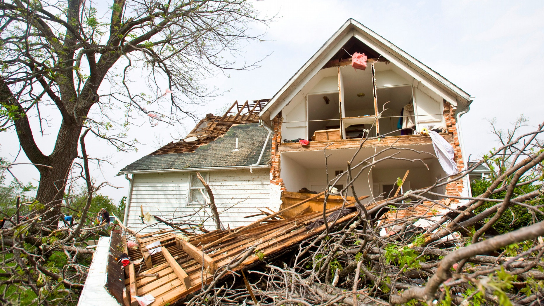 A house sits ripped-open from a tornado on Sunday, April 15, 2012 in Thurman, Iowa. Thurman appeared to be the hardest hit community in Iowa, but storms caused damage elsewhere in the state, as well as in Nebraska. There were more than 100 reports of tornadoes across the middle of the country through dawn Sunday, forecasters said. (AP Photo/The Journal-Star, Patrick Breen)