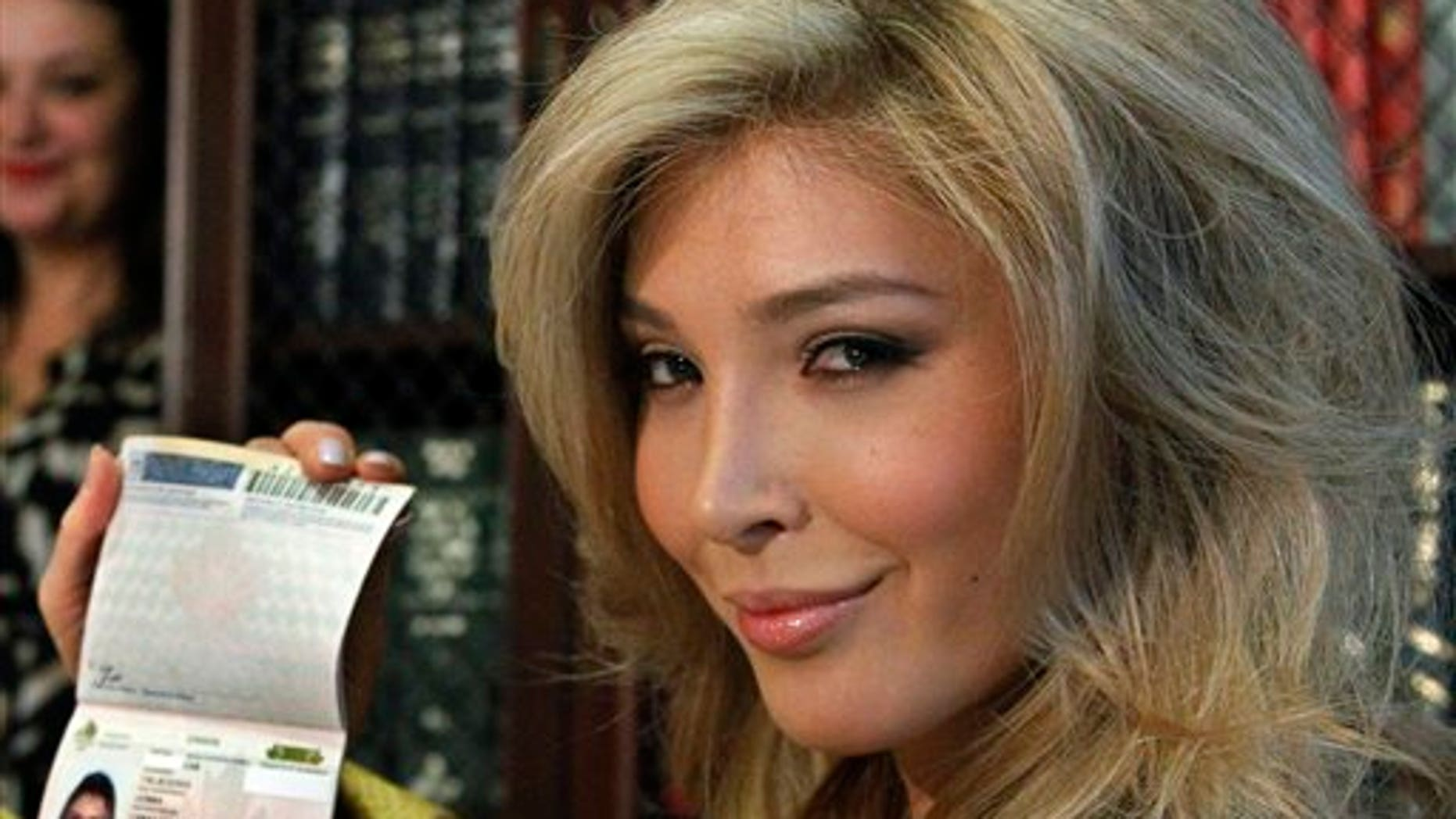 April 3: Jenna Talackova, who advanced to the finals of the Miss Canada competition, part of the Miss Universe contest, and was recently forced out of the competition, shows her passport that lists her gender as female, at a news conference in Los Angeles.