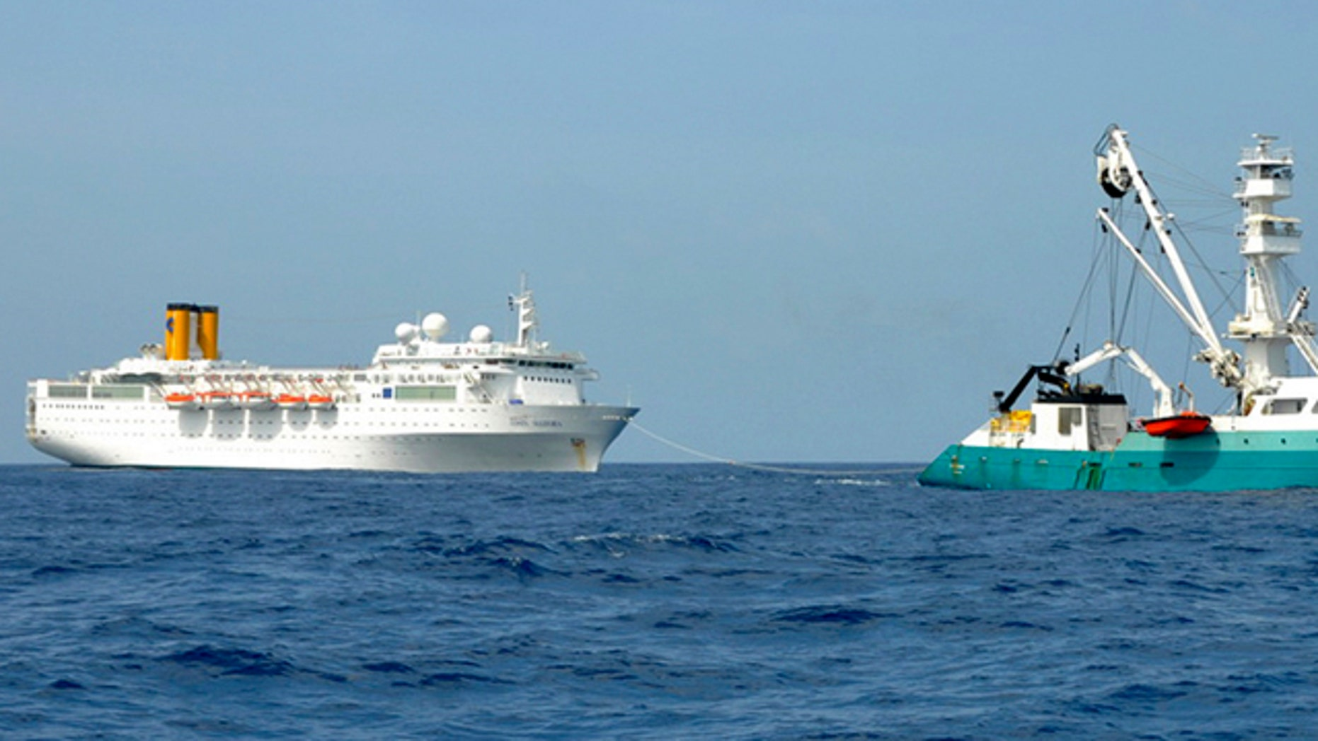 Feb. 28: In this photo taken by a member of French fishing vessel, The Talenduic, and provided by the Prefecture of the Reunion Island, shows the Italian cruise ship, The Costa Allegra, left, being towed by French fishing vessel, The Trevignon, in the Indian Ocean.