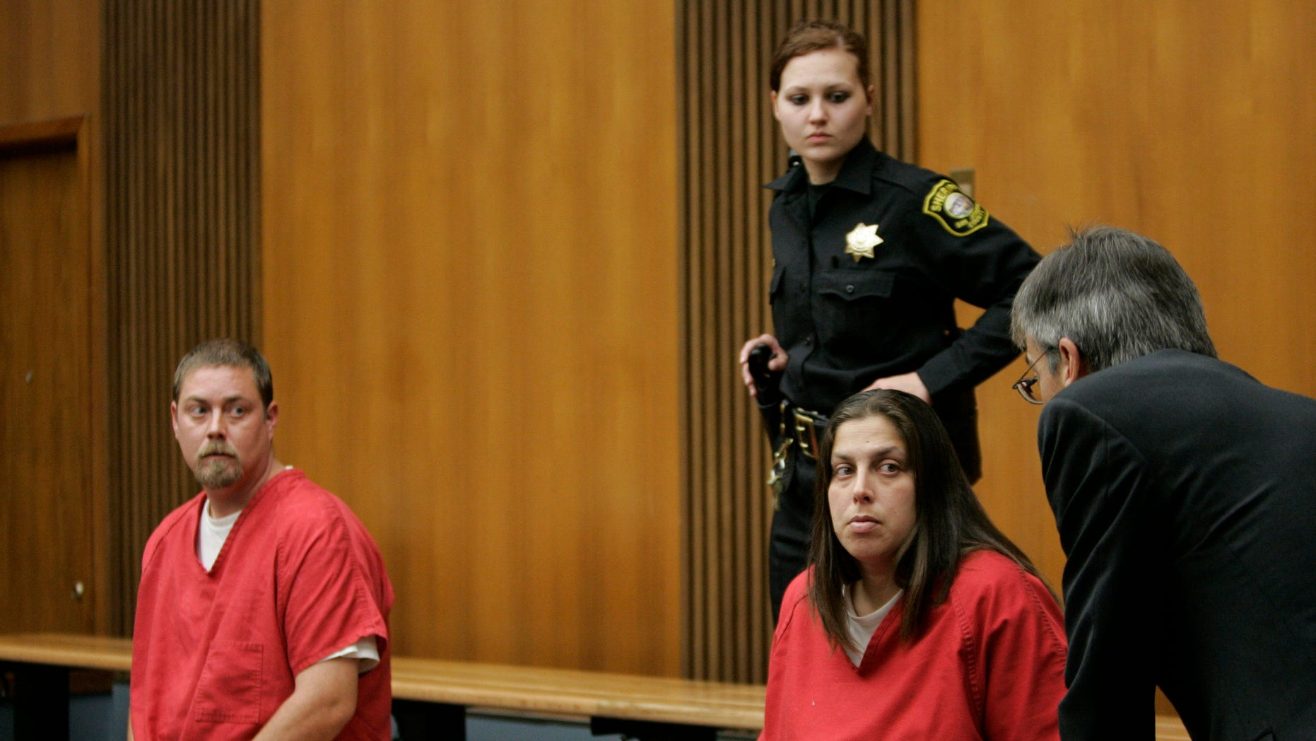 Dec. 4, 2008: Kelly Layne Lau, 30, and her husband Michael Schumacher, 34, appear in a Stockton, Calif., courtroom. Both admitted to kidnapping and torturing a then 16-year-old boy authorities say was sometimes kept shackled inside their home.