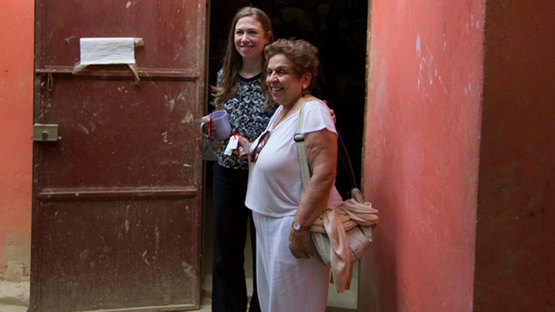 FILE - In this July 28, 2015, file photo, Chelsea Clinton, left, poses for a picture with Donna Shalala, Clinton Foundation President at Papillon Enterprise, in Port-au-Prince, Haiti. (AP Photo/Dieu Nalio Chery, File)