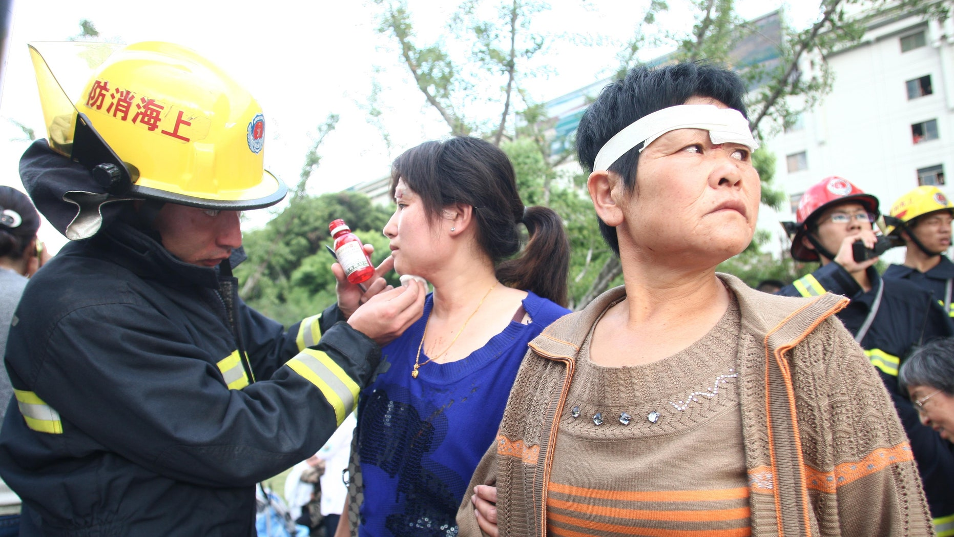 September 27: A rescue worker tends to passengers injured after a subway train accident in Shanghai.