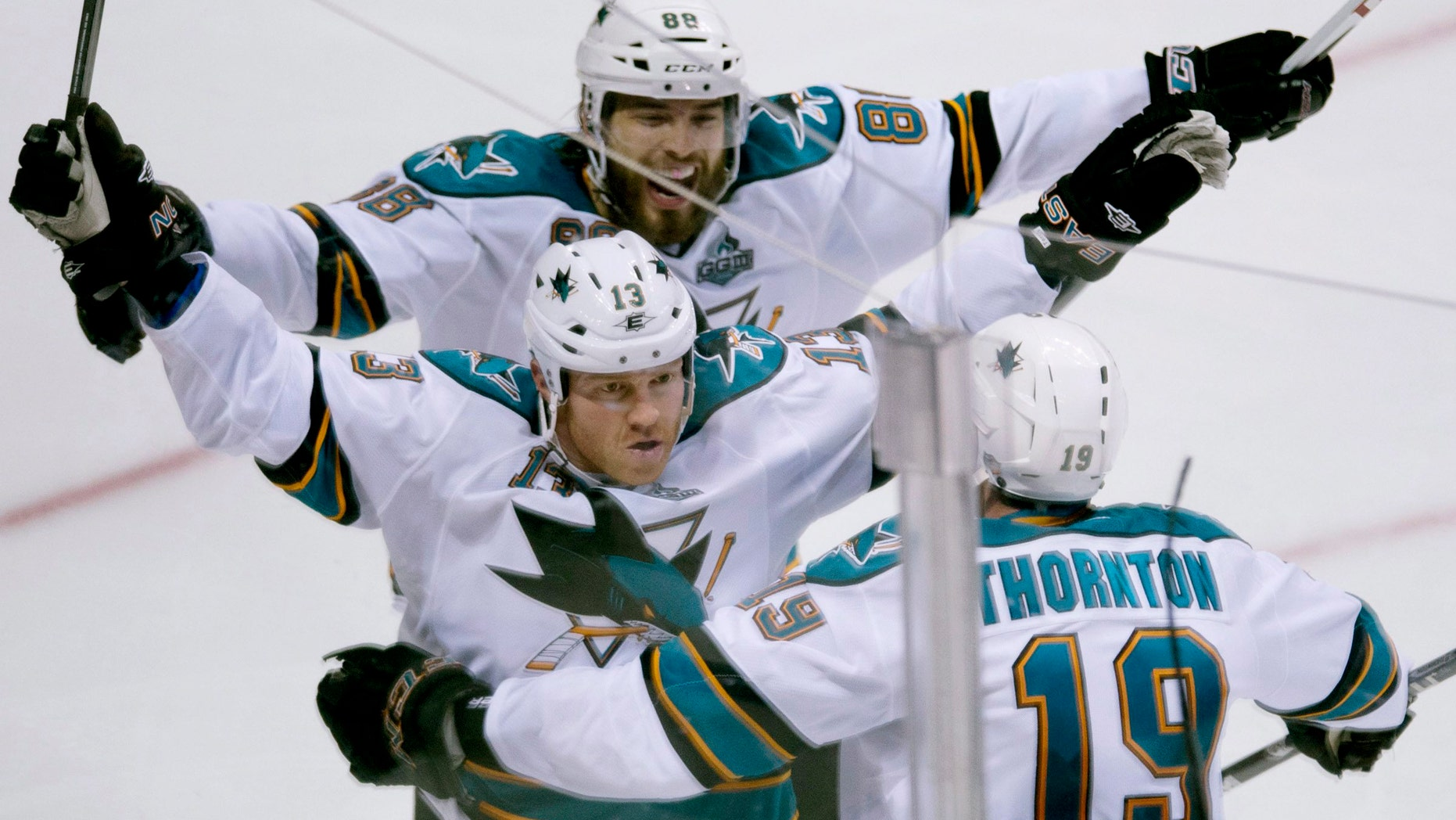 San Jose Sharks Raffi Torres (13) celebrates his game winning goal over the Vancouver Canucks with San Jose Sharks Joe Thornton (19) and Brent Burns (88) on Friday, May 3, 2013.