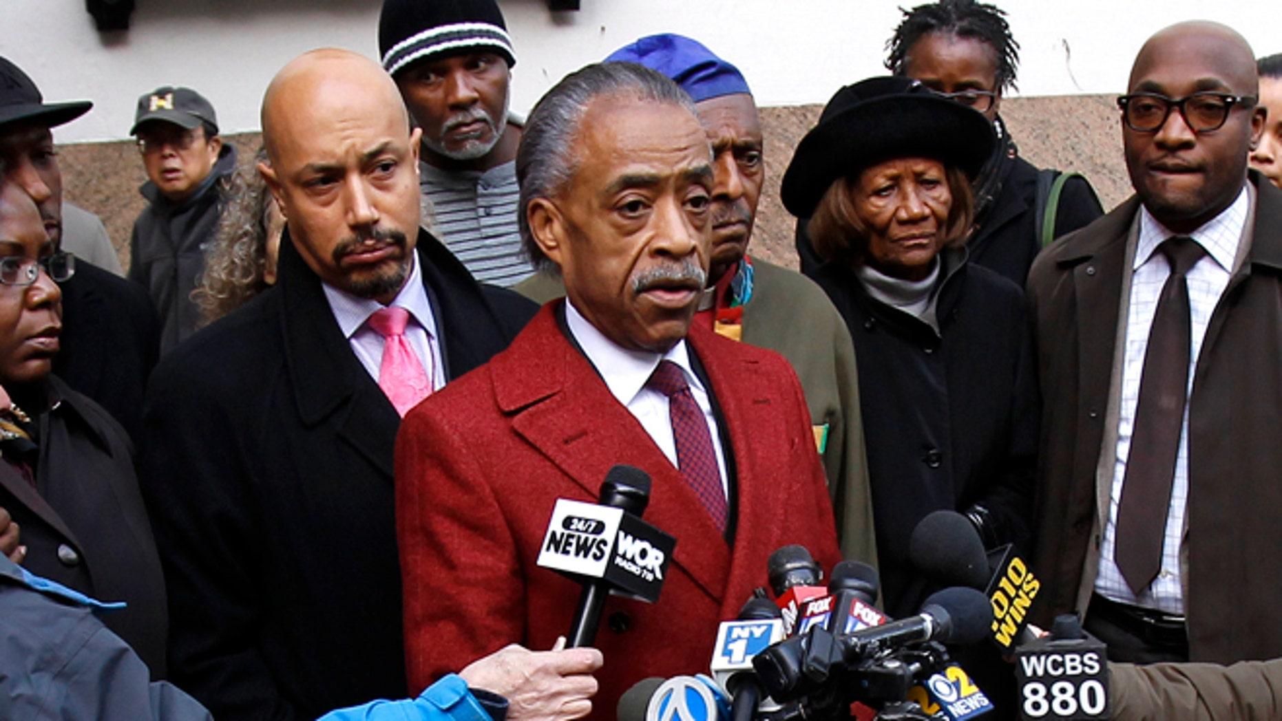 FILE: Nov. 4, 2013: The Rev. Al Sharpton speaks to the media outside Macy's department store, in New York City, N.Y.