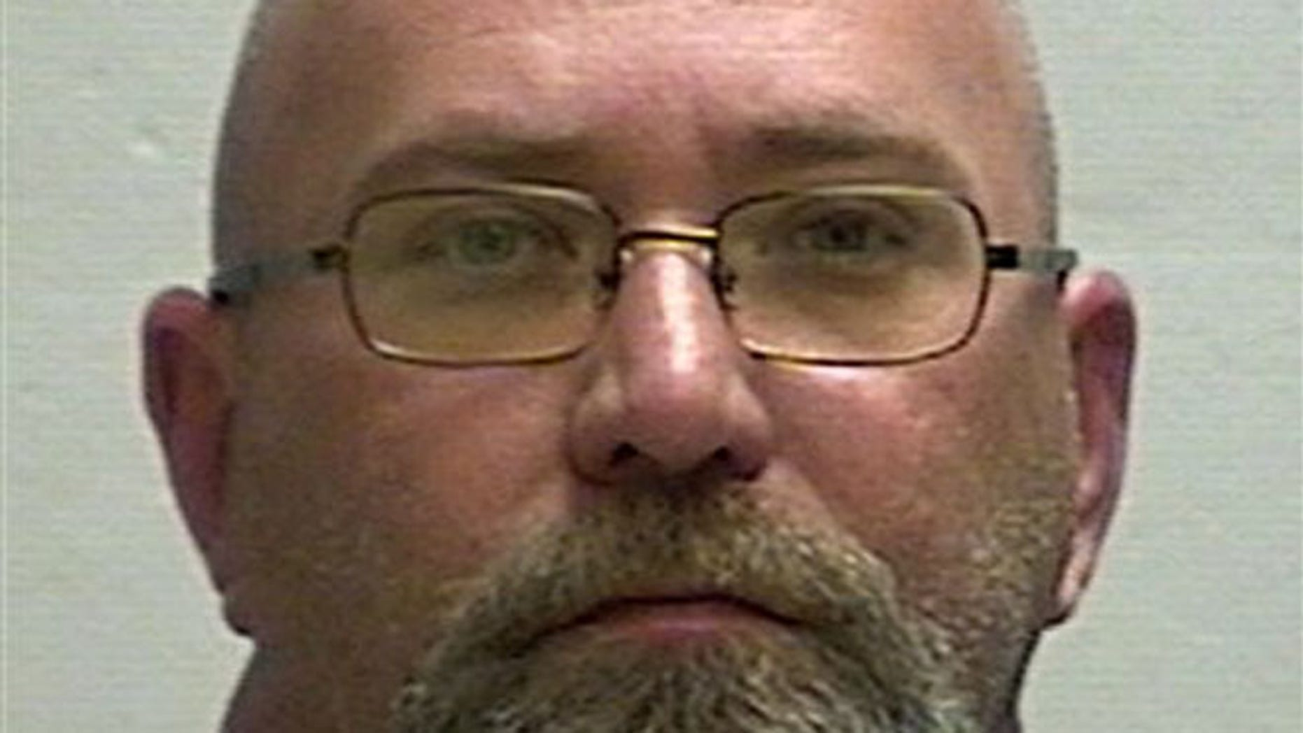 This undated file photo provided by the Clay County, Mo., Detention Center shows Rev. Shawn Francis Ratigan.