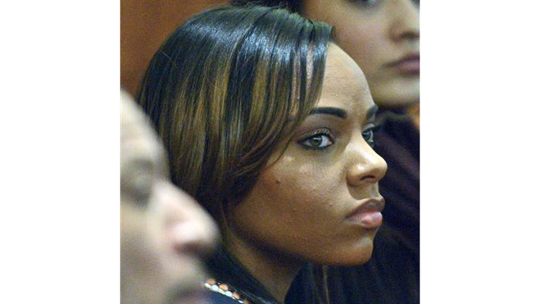 In this March 6, 2015, file photo, Shayanna Jenkins, fiancee of former New England Patriots football player Aaron Hernandez, listens during Hernandez's murder trial in Fall River, Mass.