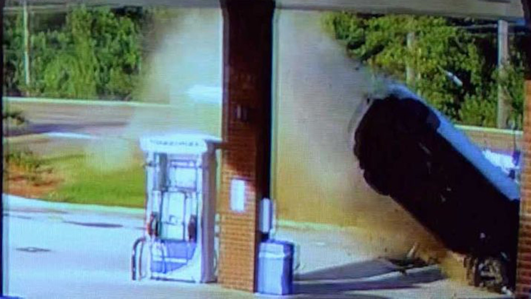 Image from video showing an out-of-control car crashing into a gas station in Flowood, Miss., Thursday.