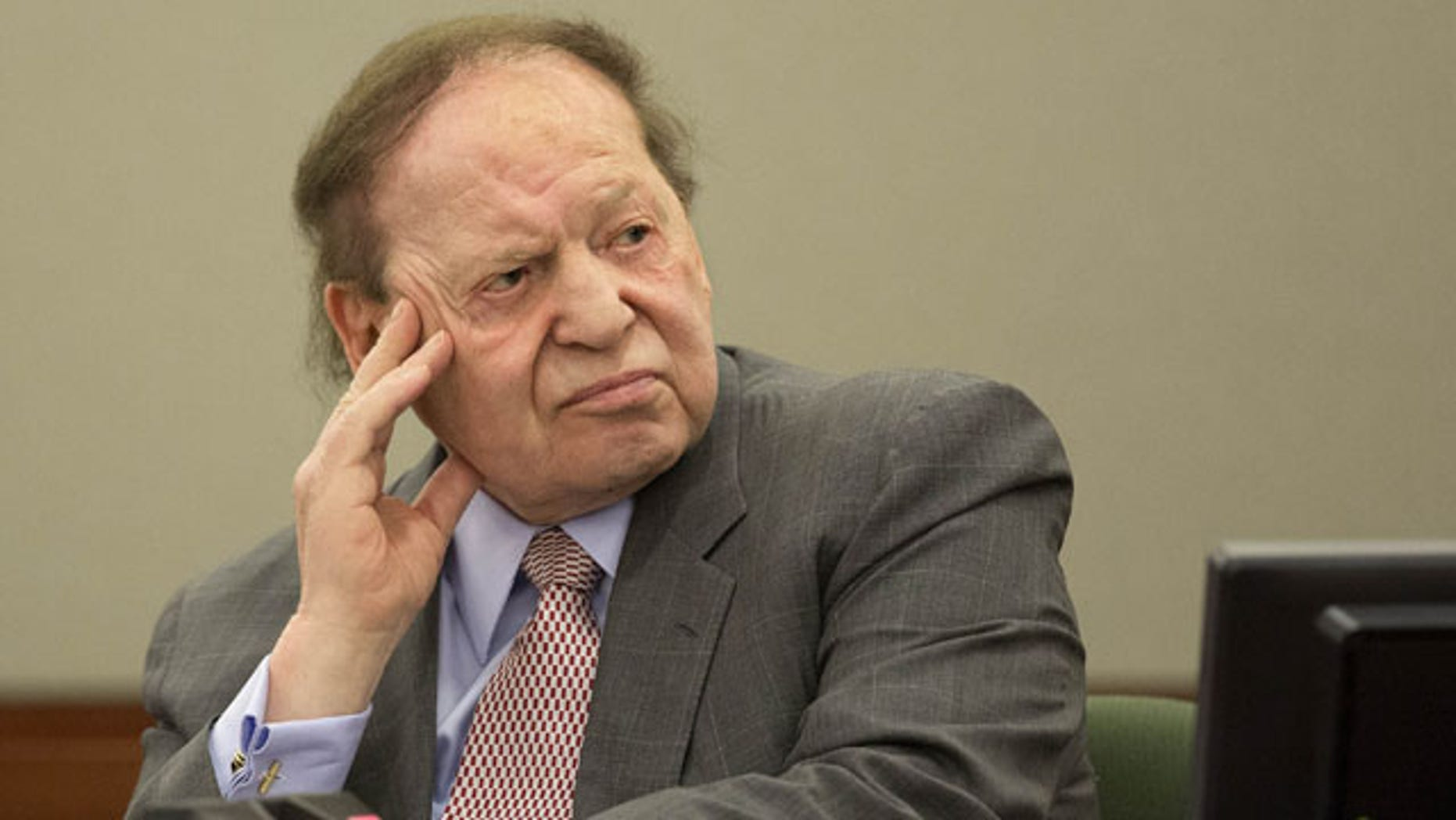 FILE - In this Friday, April 5, 2013, file photo, Las Vegas Sands Corp. CEO Sheldon Adelson testifies in Clark County district court in Las Vegas. (AP Photo)