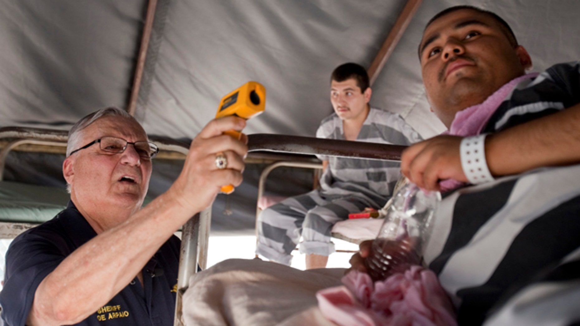 Phoenix hit a record high of 118 degres today. Maricopa County Sheriff Joe Arpaio  inspects the heat inside the tents while Baron Hernandez  lies on a bed at the Tent City jail on July 2, 2011 in Phoenix, Arizona.    (AP Photo/The Arizona Republic, Patrick Breen)
