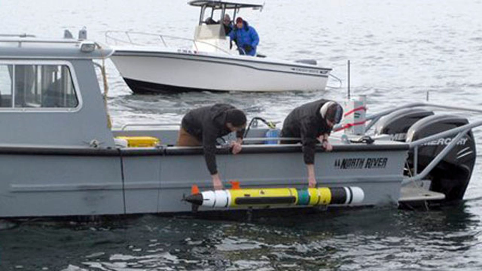 Feb. 8, 2012: Researchers lower an underwater robot into Block Island Sound off the Westerly, R.I., coast.