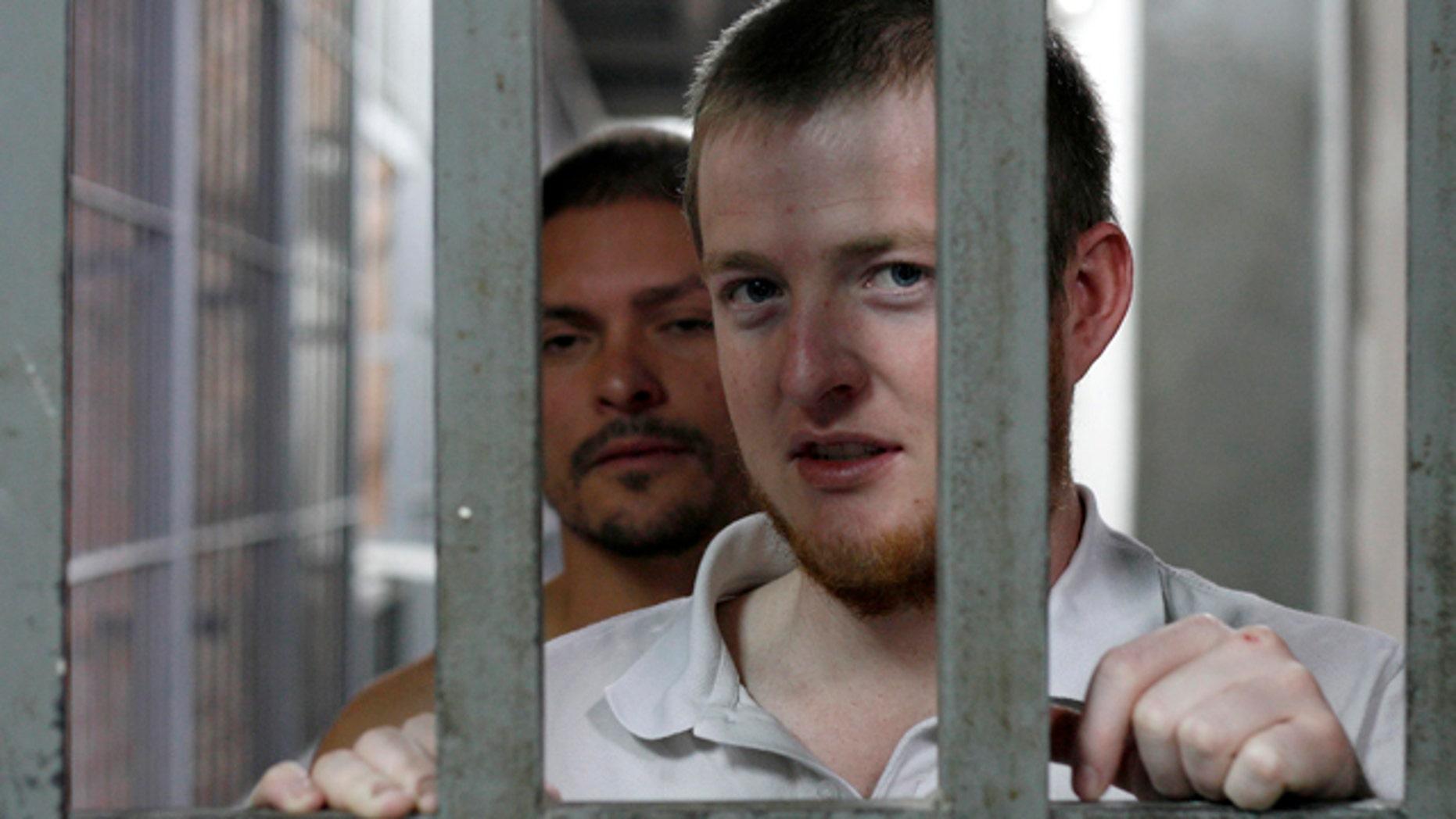 September 24, 2010: Shohn Huckabee (front) and Carlos Quijas, U.S. citizens and inmates at the jail in Ciudad Juarez talk to Reuters.