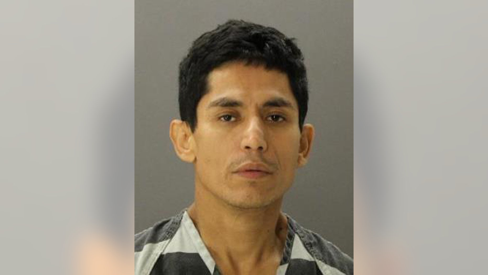 Juan Navarro Rios on a jail booking photo provided by the Dallas County Sheriff's Department.