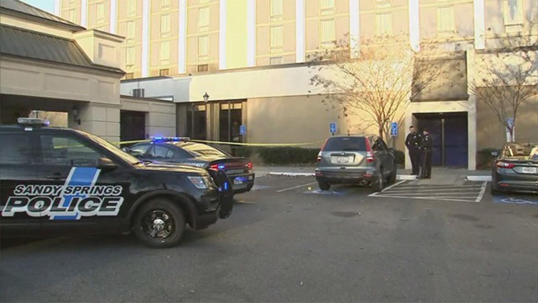 An FBI agent attempted to make an arrest at a hotel Friday in Sandy Springs, Ga., when he got caught on a truck being driven by the suspect and subsequently dragged through the Atlanta suburb.