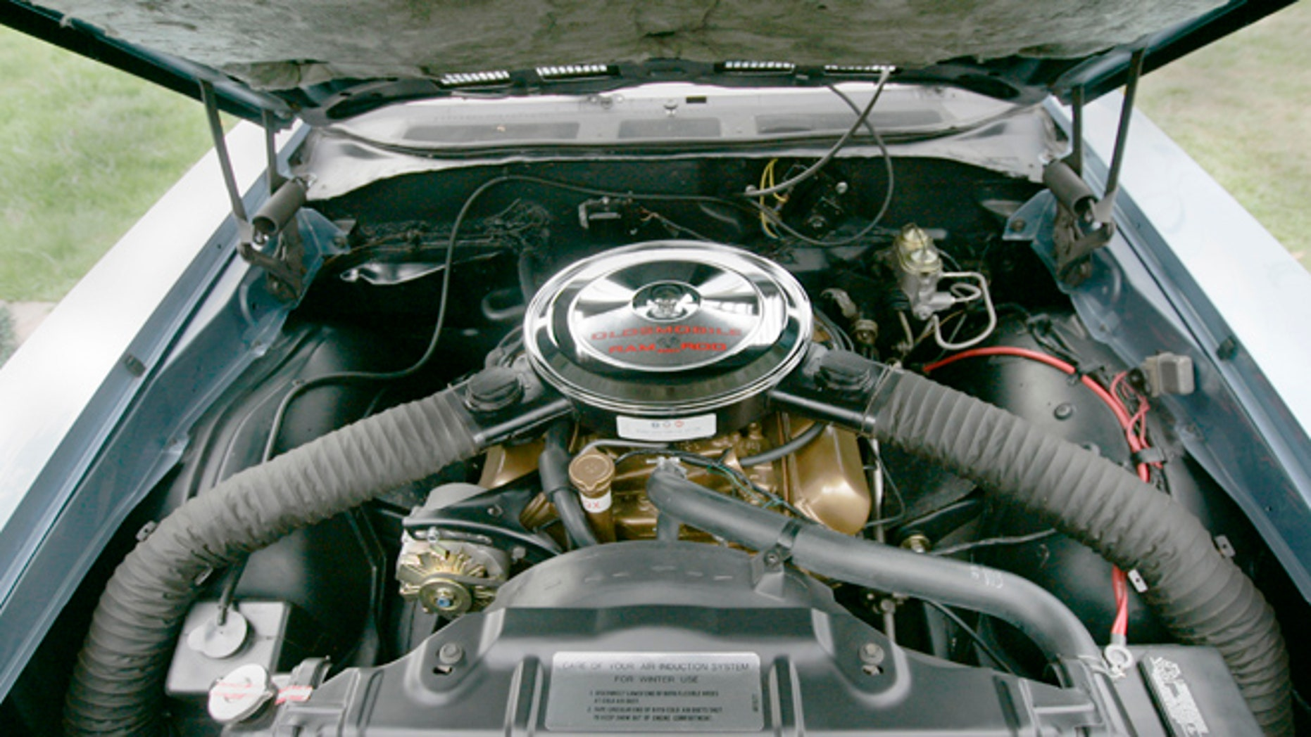 FILE- This Sept. 16, 2008 file photo shows the engine compartment of Scott Pierce's 1969 Oldsmobile F-85 with the W-31 engine performance package, in MEriden, Conn.Back when gas was cheap, Americans bought cars with V-8 engines like the Big Block, Cobra Jet and Ramcharger, but now, thanks to government regulation and gas-price gyrations, the motors that move the nations cars and trucks are shrinking. (AP Photo/The Record-Journal, Johnathon Henniger)**MANDATORY CREDIT, MAGS OUT, NO SALES**