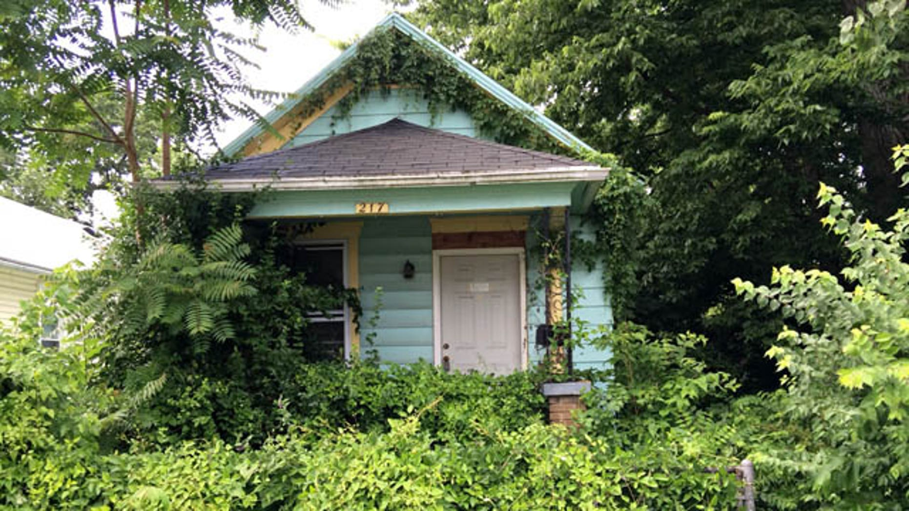 June 16, 2014: This photo shows the vacant house in Dayton, Ohio where an adolescent boy found the mummified body of a man hanging in a closet Sunday.  (AP Photo/The Dayton Daily News, Marshall Gorby)