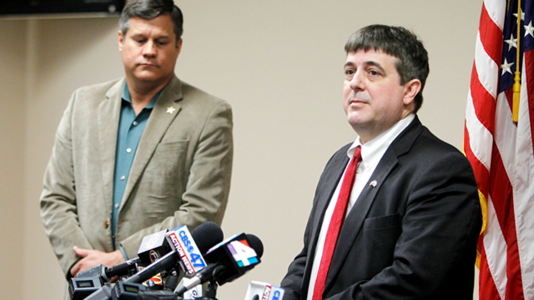 Jan. 7, 2015: Columbia County State Attorney Jeff Seigmeister speaks during a press conference in Lake City, Fla. about two Columbia County girls accused of killing their brother. Columbia County Sheriff Mark Hunter, left, also spoke. (AP Photo/Matt Stamey, The Gainesville Sun)