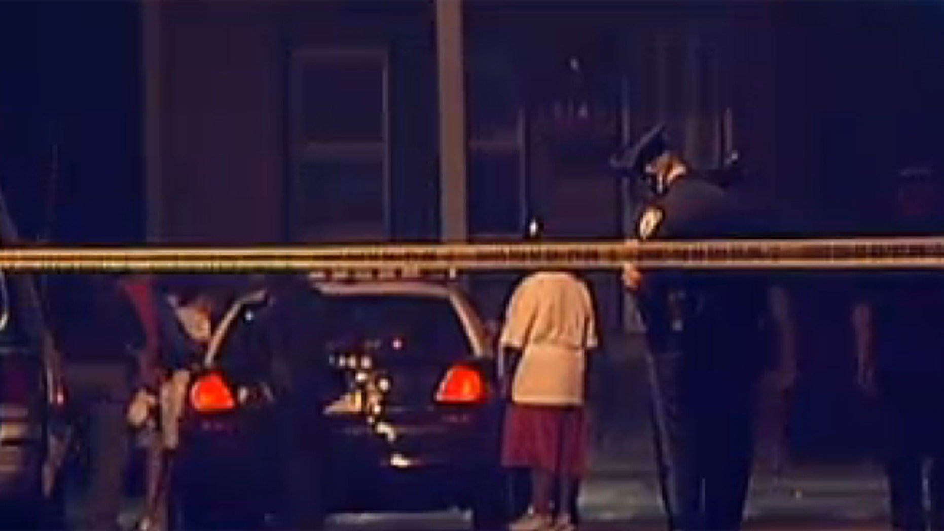 Sept. 1, 2012: The scene outside a home where siblings were stabbed while sleeping.