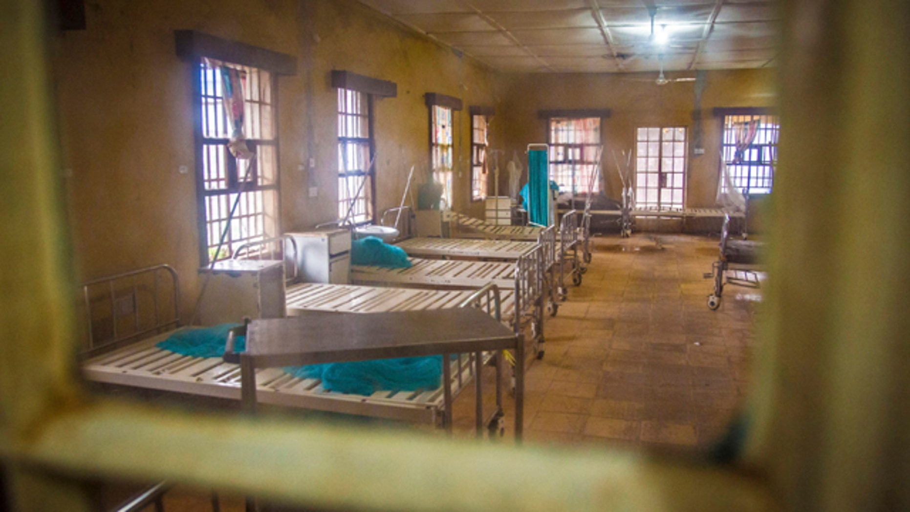 FILE - In this Sunday, Aug. 10, 2014 file photo, a ward at the government hospital in Kenema, eastern Sierra Leone lies empty after patients left and others were scared to be admitted, fearing they would contract the Ebola virus. (AP Photo/Michael Duff, File)