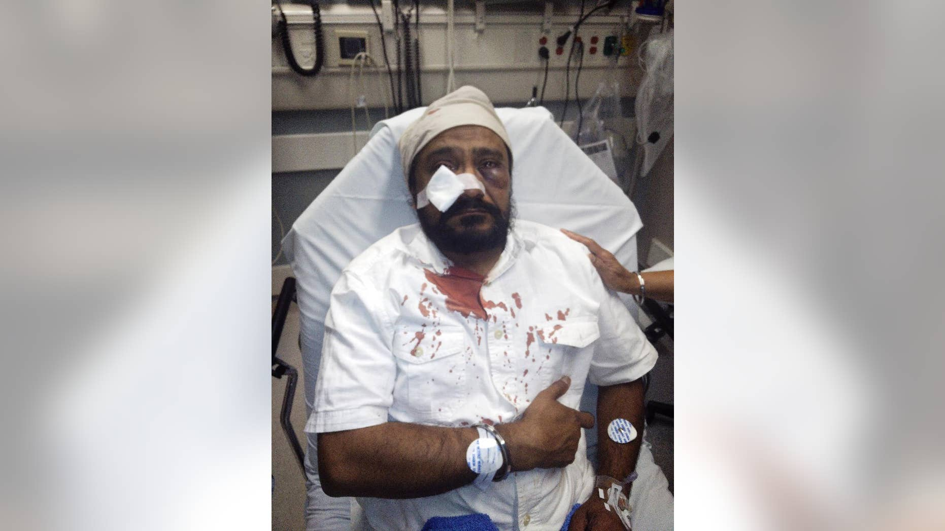 In this Sept. 8, 2015 photo provided by The Sikh Coaliton, 53-year-old Inderjit Mukker is seen at a hospital in Hinsdale, Ill., following an attack authorities say was a road rage incident in Darien, Ill. On Tuesday, Sept. 15, prosecutors said a suburban Chicago teenager who had already been charged with punching the Sikh man has now been charged with a hate crime. (The Sikh Coalition via AP)