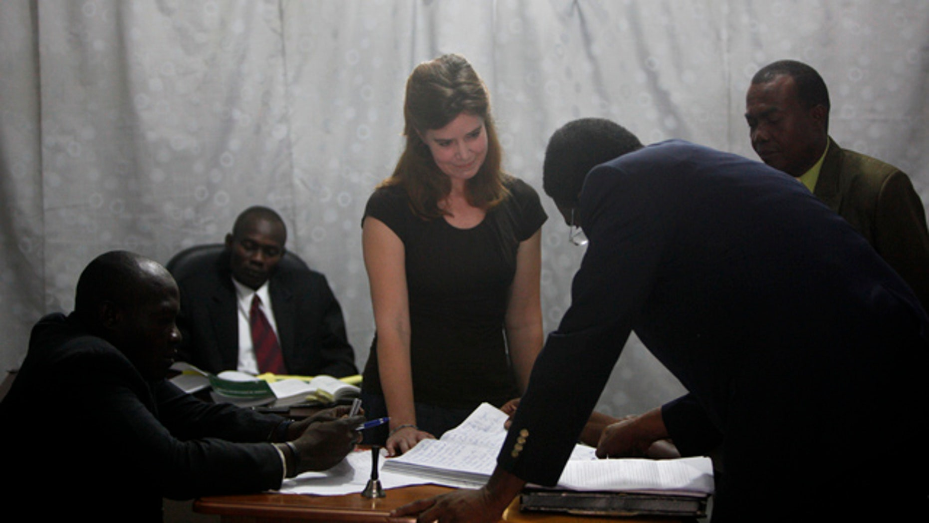 May 13: U.S. missionary Laura Silsby, center, appears in a Port-au-Prince courthouse on the first day of her trial.