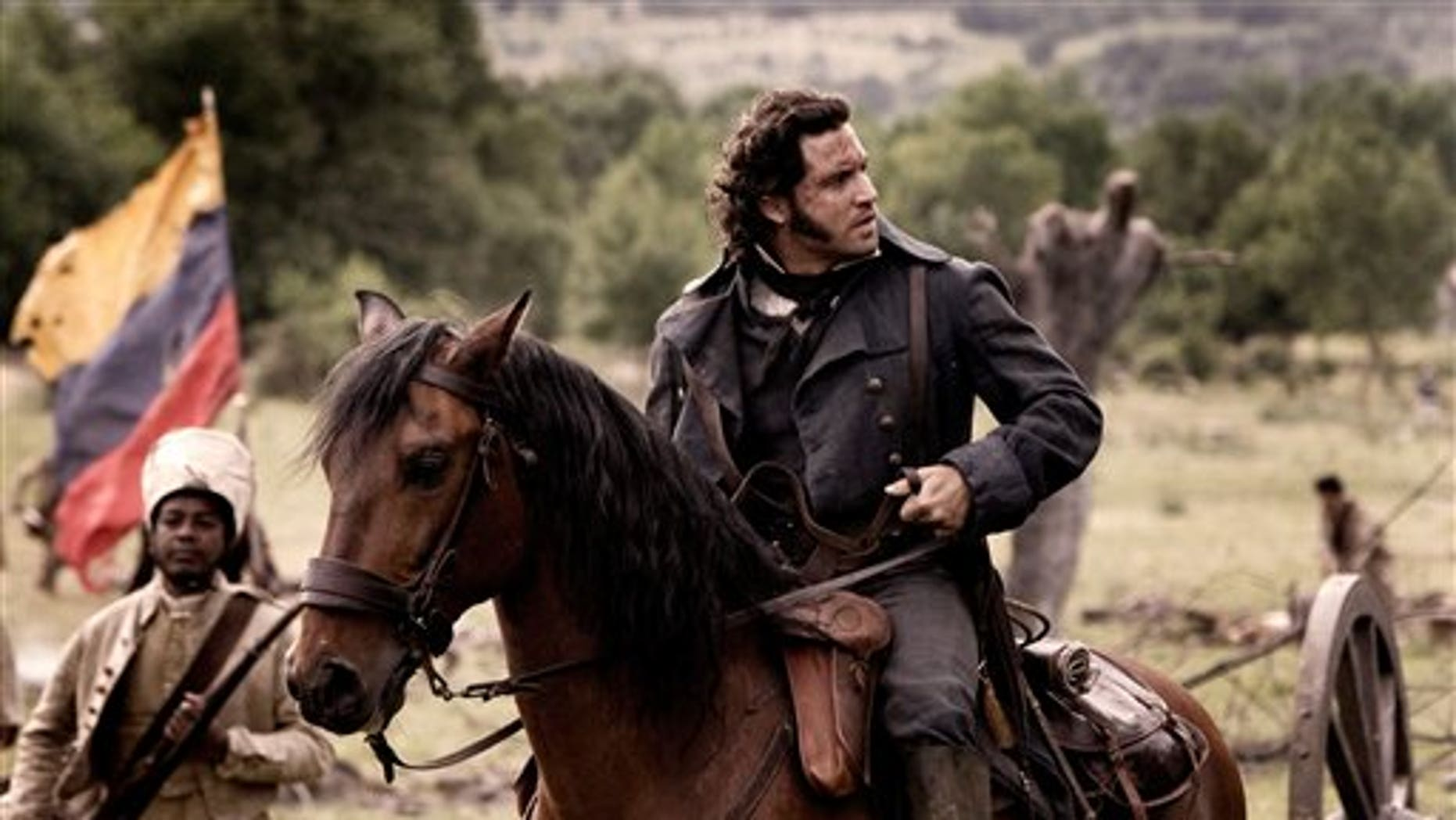 """In this March 2012 file photo released by Producciones Insurgentes Jota Erre Medios, Venezuelan actor Edgar Ramirez is seen during the filming of """"The Liberator, at Rascafria, Spain. Latin Americas greatest hero is finally getting a big-budget, Hollywood-style epic befitting his towering figure. Simon Bolivar, who led the liberation of much of South America from the Spanish in the early 19th century, is the subject of The Liberator, a two-hour epic that is among the costliest movies ever produced in Latin America. (AP Photo/Teresa Isasi)"""