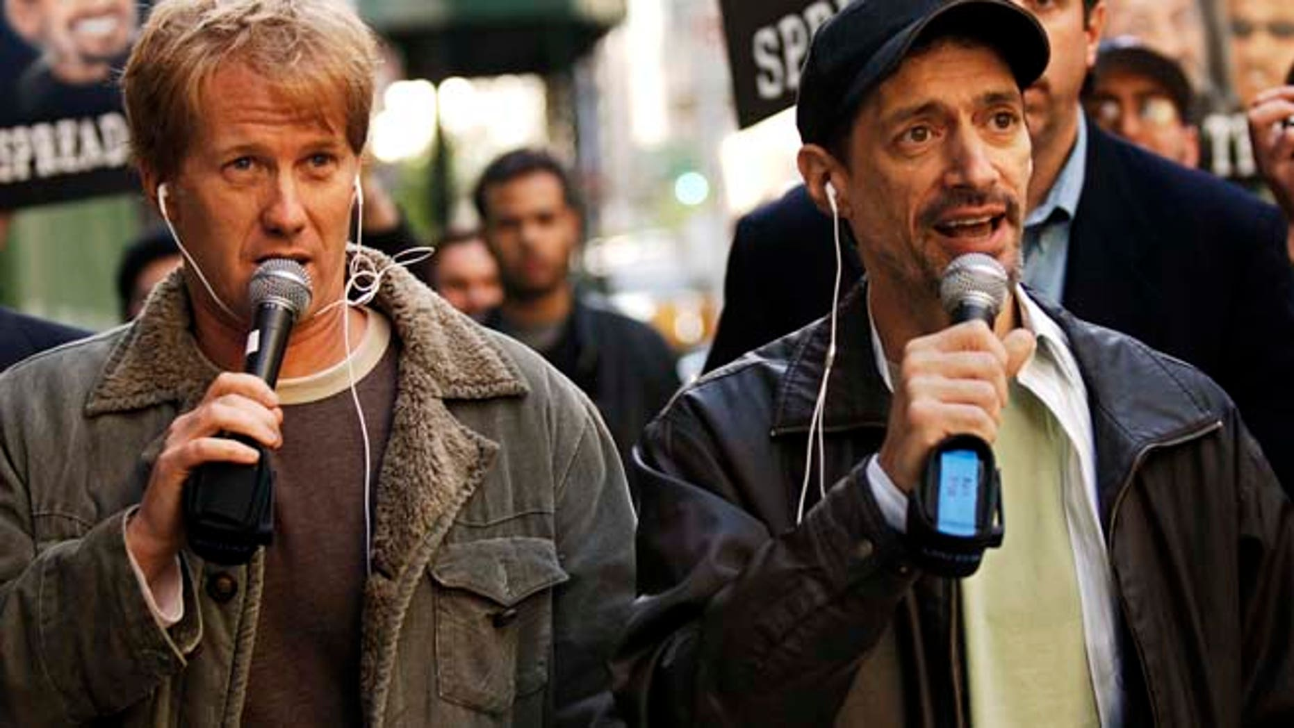 """In a April 26, 2006 file photo, radio shock jocks Greg """"Opie"""" Hughes, left, and Anthony Cumia, right, leave CBS Radio studios on 57th Street with fans after finishing their first morning show, in New York.  (AP)"""