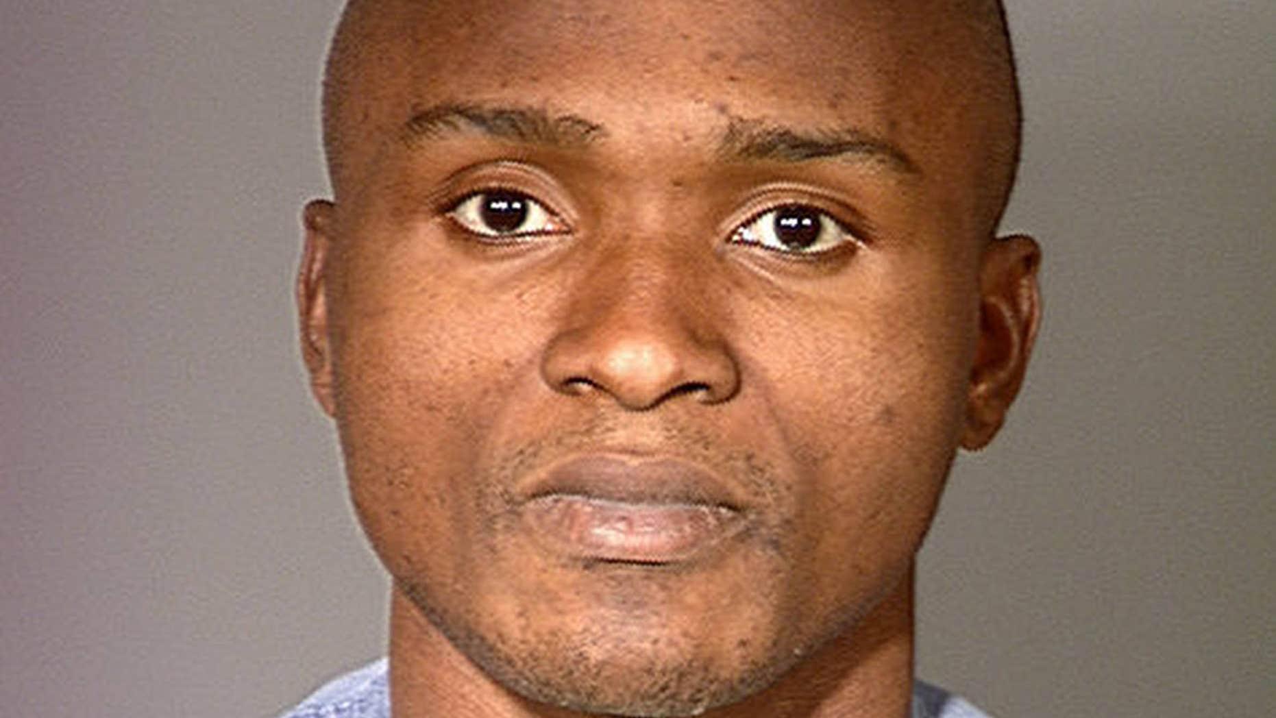 Feb. 2000: Charly Keundeu Keunang after his arrest for robbery.