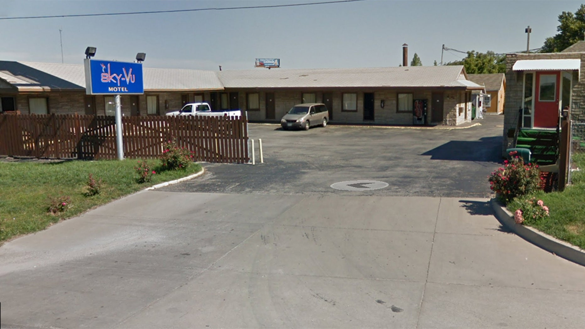 Two undercover cops were working on an investigation at the Sky-Vu Motel (pictured) in Kansas City, Missouri, when they were shot about 12:15 p.m. One of the three wounded officers was hit after police started to exchange gunfire with the suspect. (Google Maps)