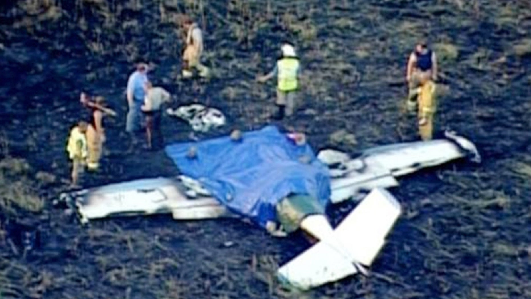 This Monday, July 27, 2015 photo from video provided by KSTP-TV shows the scene of a plane crash near Amery, Wis.