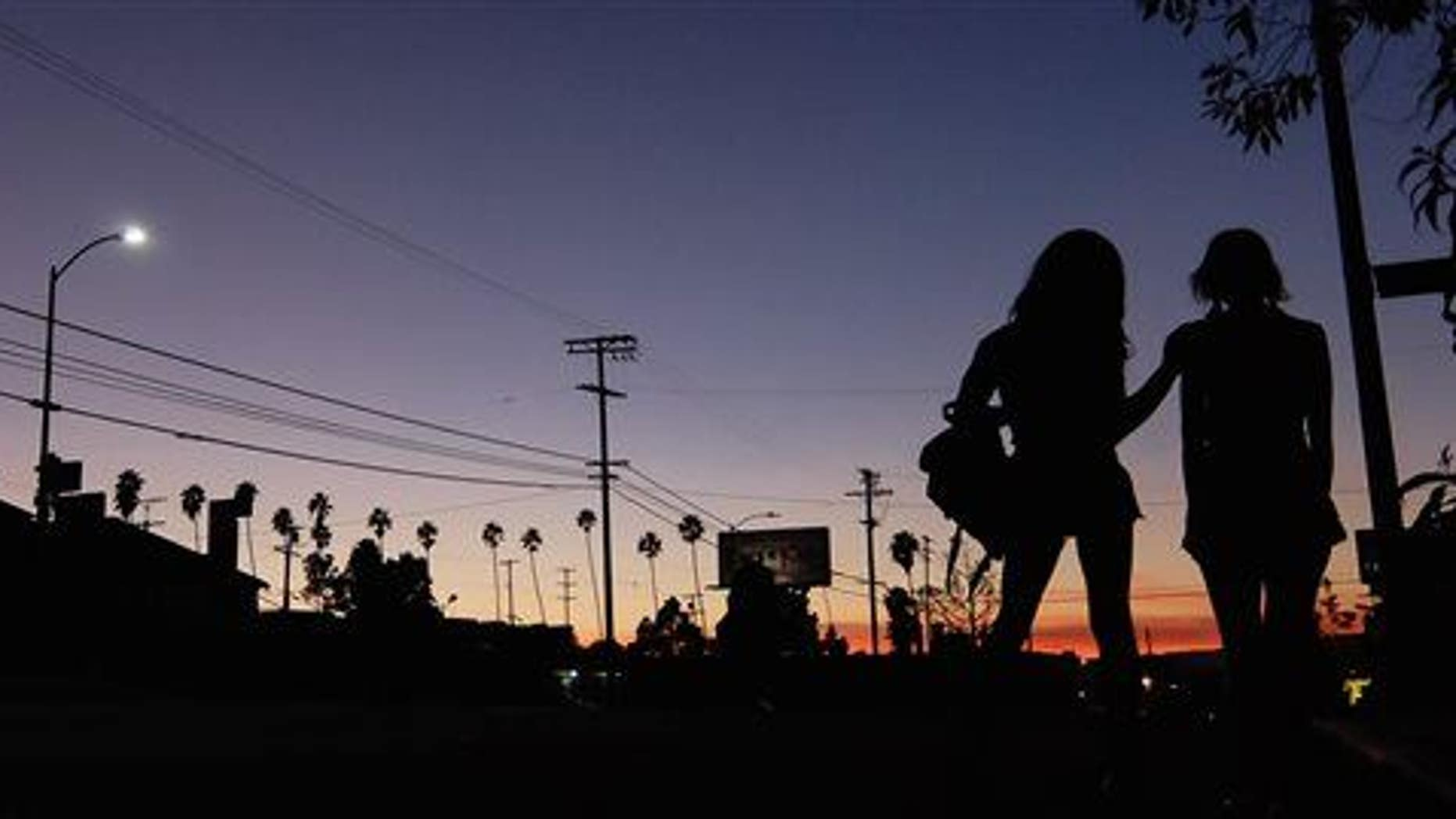"""This photo provided by courtesy of the Sundance Institute shows a scene from the film, """"Tangerine,"""" directed by Sean Baker."""