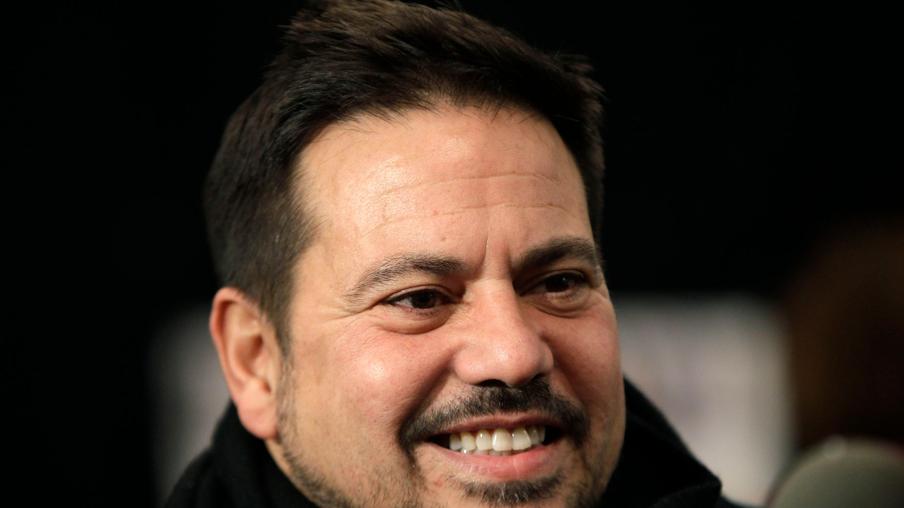 FILE - This Feb. 15, 2011 file photo shows designer Narciso Rodriguez backstage before the presentation of his Fall 2011 show at Lincoln Center during Fashion Week in New York. Rodriguez will receive a National Design Award this year from the Smithsonian's Cooper-Hewitt National Design Museum, along with 10 other top names in design. Rodriguez designed the black and red dress worn by first lady Michelle Obama in Chicago on election night in 2008. The dress recently went on display at the National Archives to represent her signature style. Earlier, Rodriguez designed Carolyn Bessette's wedding dress for her 1996 marriage to John F. Kennedy Jr. (AP Photo/Kathy Willens, File)