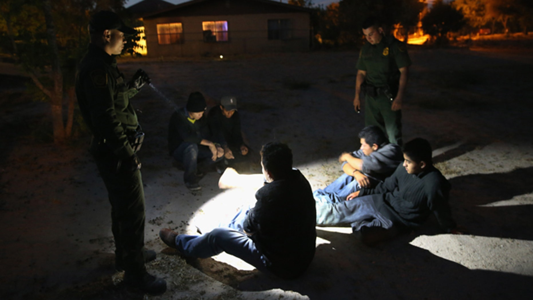 MISSION, TX - APRIL 11: U.S. Border Patrol agents detain undocumented immigrants who had crossed from Mexico into the United States on April 11, 2013 in Mission, Texas. In the last month the Border Patrol's Rio Grande Valley sector has seen a spike in the number of immigrants crossing the river from Mexico into Texas. With more apprehensions, they have struggled to deal with overcrowding while undocumented immigrants are processed for deportation. According to the Border Patrol, undocumented immigrant crossings have increased more than 50 percent in Texas' Rio Grande Valley sector in the last year. Border Patrol agents say they have also seen an additional surge in immigrant traffic since immigration reform negotiations began this year in Washington D.C. Proposed refoms could provide a path to citizenship for many of the estimated 11 million undocumented workers living in the United States.  (Photo by John Moore/Getty Images)