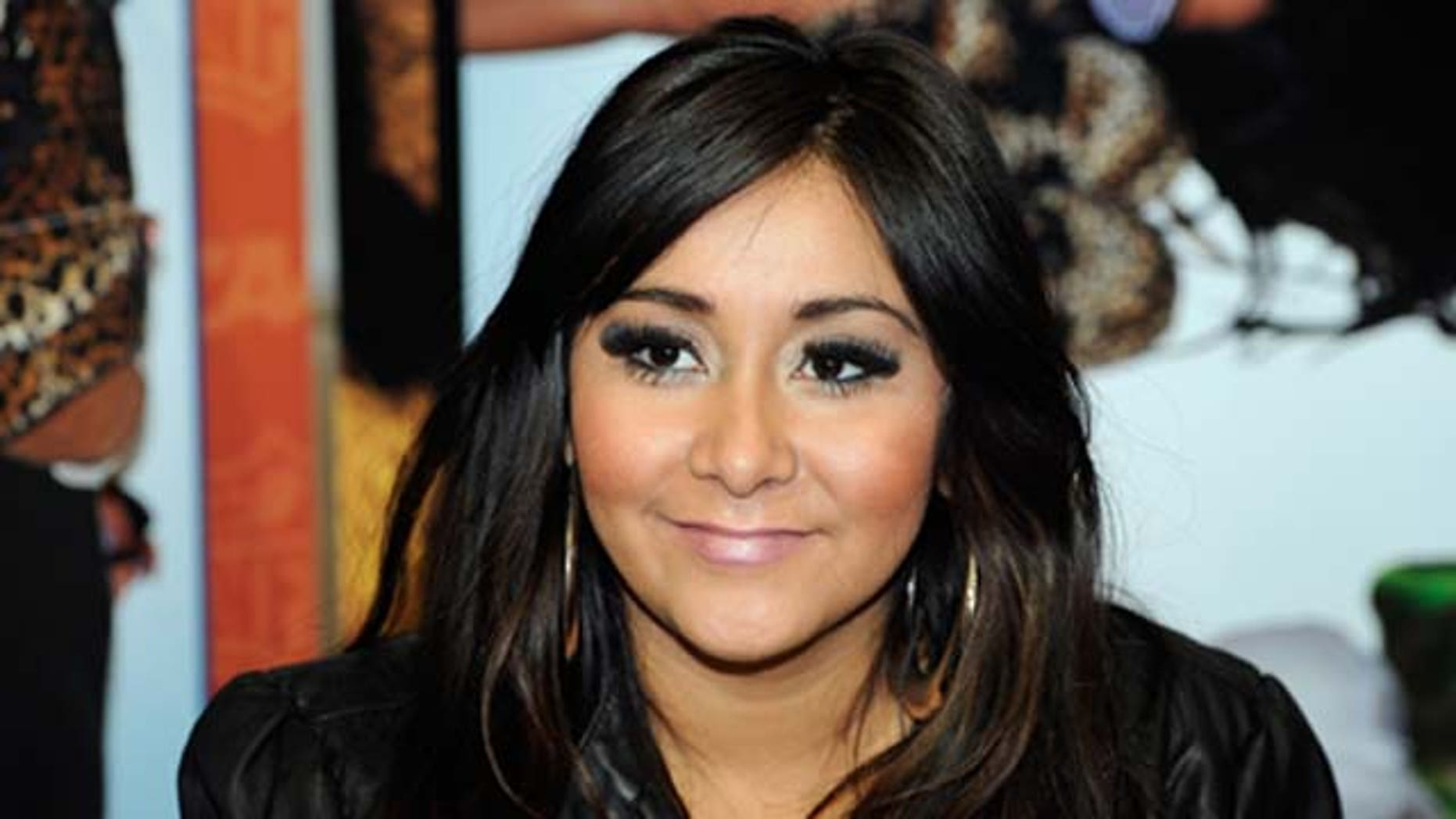 """Television personality Nicole """"Snooki"""" Polizzi promotes her Snooki Slippers line licensed by Happy Feet at the MAGIC clothing industry convention at the Las Vegas Convention Center February 15, 2011 in Las Vegas, Nevada."""