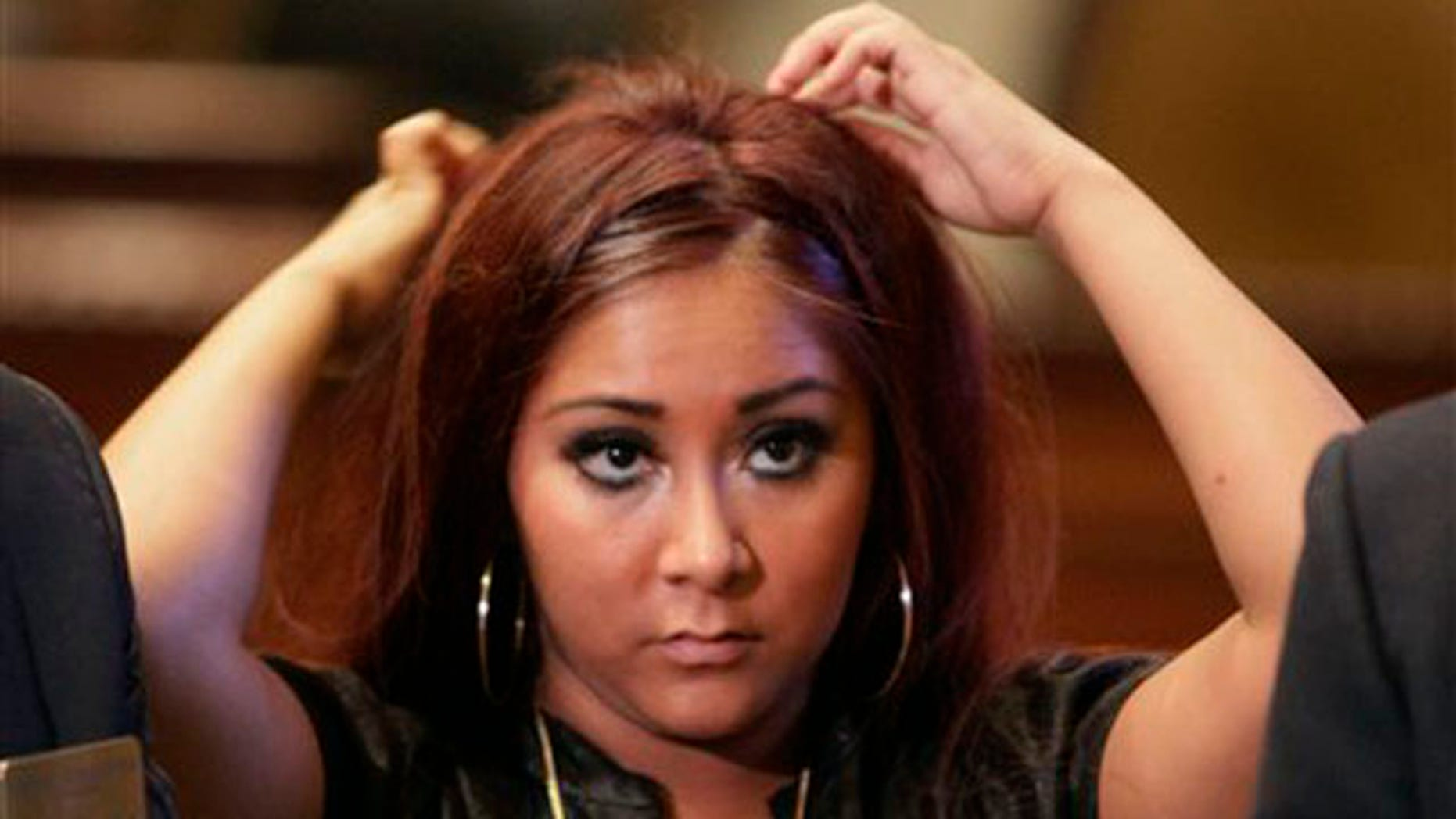 "Nicole ""Snooki"" Polizzi , a cast member of MTV's ""Jersey Shore"" reality series is shown at the New York Stock Exchange three days before getting arrested for disorderly conduct in Seaside Heights, NJ."