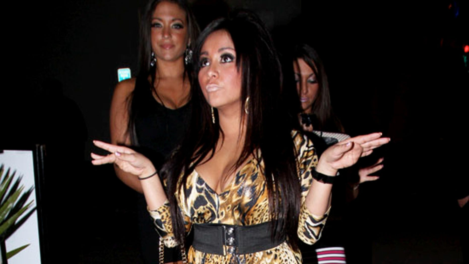 Nicole 'Snooki' Polizzi sizzles in her animal print at Voyeur in West Hollywood, CA on March 4, 2011. X17online.com