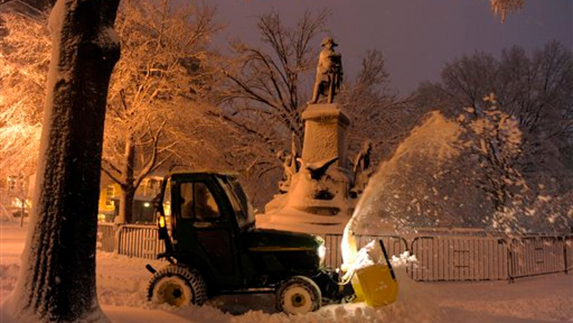 Feb. 6: A worker plows snow to clear a sidewalk in Lafayette Park, across from the White House in Washington.